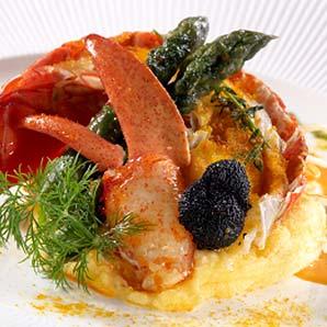 Cassolette de homard aux petits légumes sauce corail